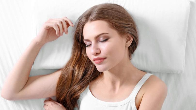 a girl sleeping on a comfy mattress