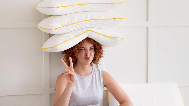 eve memory foam pillows on woman's head
