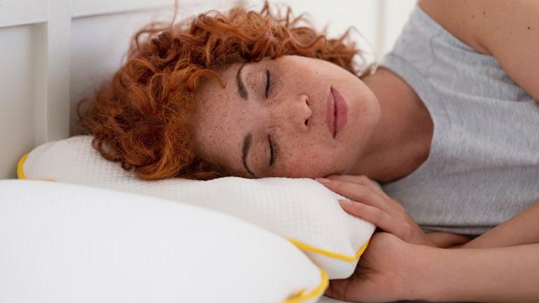A Woman sleeping on a eve pillow