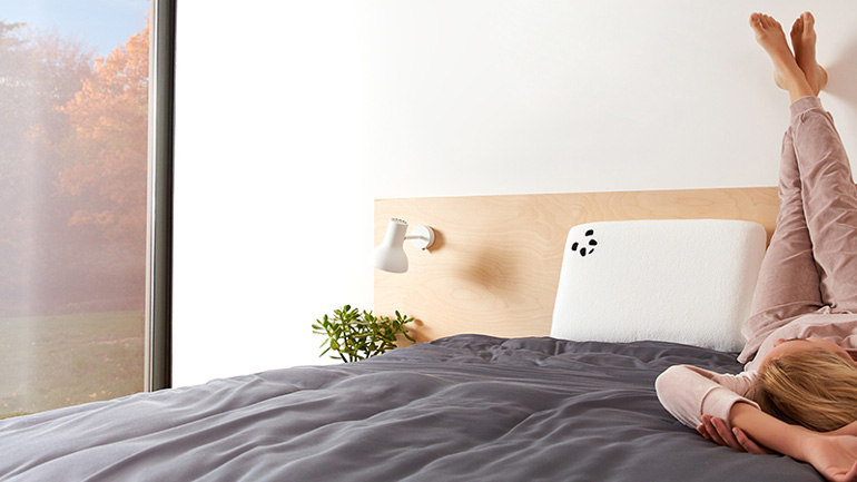 Panda Memory Foam Bamboo Pillow in bedroom with a woman laying next to it