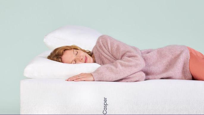 A woman Sleeping on a Casper pillow