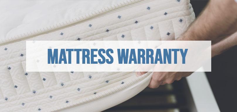 a man checking a matress for a mattress warranty